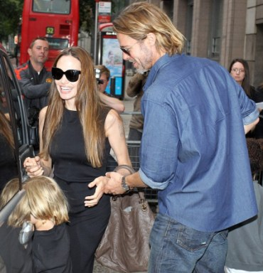 Brad and Angelina were beaming as they herded their happy brood to a waiting car