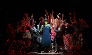 "Jessica Vosk as Elphaba and Ginna Claire Mason as Glinda, with the cast of ""Wicked,"" now at the Boston Opera House. [Courtesy Photo/Joan Marcus]"